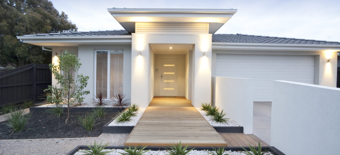 Facade and entry to a contemporary white rendered home in Australia.
